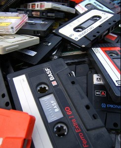 A pile of cassette tapes. with the tape rolled in